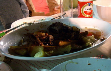 baked-baby-goat-and-potatoes